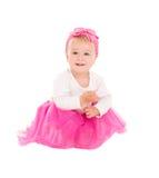 桃红色芭蕾舞短裙的微笑的女婴 免版税库存照片