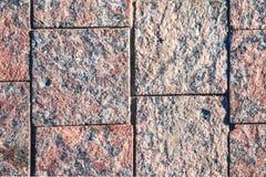 桃红色花岗岩铺路板  免版税库存图片