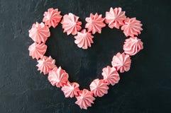 桃红色蛋白甜饼 库存照片