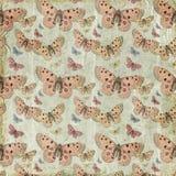桃红色蝴蝶重复模式背景 免版税库存照片