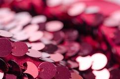 桃红色衣服饰物之小金属片塑造织品亮光 图库摄影