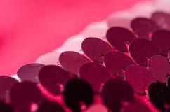 桃红色衣服饰物之小金属片塑造织品亮光 库存照片