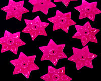 桃红色衣服饰物之小金属片星形 库存图片