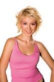桃红色衬衣微笑的青少年的妇女 图库摄影