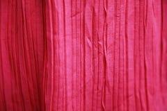 桃红色被弄皱的织品背景 库存照片