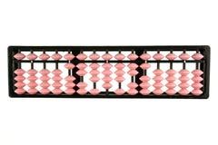 桃红色被隔绝的算盘减速火箭的日本计算器 免版税库存照片