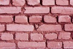 桃红色被风化的砖墙纹理 免版税库存图片