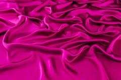 桃红色豪华丝绸,波浪织品 免版税库存图片
