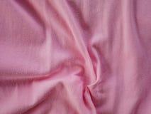 桃红色软的丝绸缎纹理,五颜六色的棉织物背景 免版税库存图片