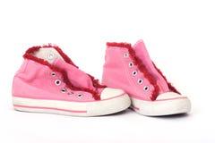 桃红色运动鞋 库存照片