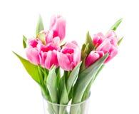 桃红色郁金香花束在花瓶的 库存照片