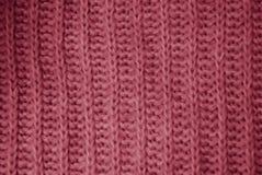 桃红色针织品背景 免版税库存照片