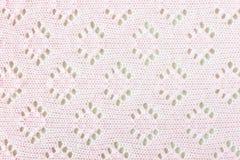 桃红色钩针编织布料纹理背景 库存照片