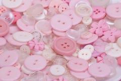 桃红色,白色和透明按钮 免版税库存照片