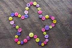 桃红色,紫色和yellew缝合的按钮花 库存照片