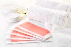 桃红色给打蜡的小条、奶油和机油 图库摄影