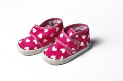 桃红色children';在白色背景隔绝的s运动鞋 Children'?s?? 女孩的鞋子 免版税库存照片