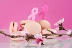 桃红色macarons为桃红色丝带10月慈善月 图库摄影