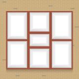 画框拼贴画在砖墙上的 库存照片