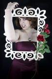 从框架出来的美丽的妇女 免版税库存照片