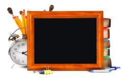 框架和学校工具 在空白背景 免版税库存照片