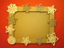 框架和钩针编织亚麻制圣诞节装饰 图库摄影