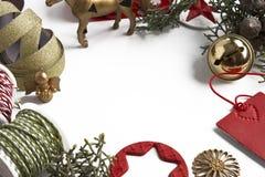 框架在白色背景的圣诞节装饰品 免版税库存图片