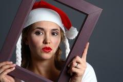 框架女孩圣诞老人 库存图片