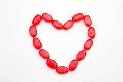 框架心脏标志由甜糖果制成 库存图片
