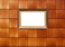 框架照片铺磁砖了墙壁 免版税图库摄影