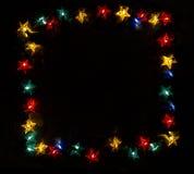 框架由星彩色小灯做成 库存图片