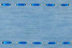 框架由最高荣誉制成插入与牛仔布织品 免版税库存照片