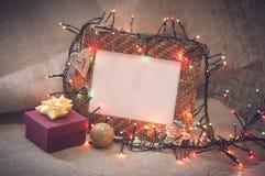 桌面照片框架和圣诞节装饰与礼物盒 免版税库存图片