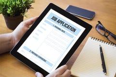 桌面片剂工作申请书 免版税库存照片