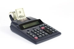 桌面计算器纸带与金钱美国人一百元钞票 免版税库存图片