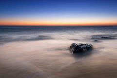 从桑迪勾子新泽西的海景日出 库存图片