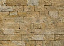 桑迪黄色石墙 免版税库存照片