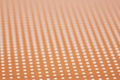 桔子和白色被察觉的表面 免版税库存照片