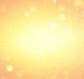 桔子和金抽象bokeh光 defocused的背景 库存图片