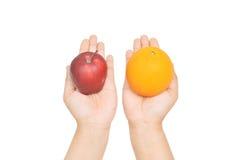 桔子或苹果计算机 免版税库存图片