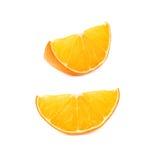 桔子的干切片部分被隔绝在白色背景,套不同的foreshortenings 库存照片