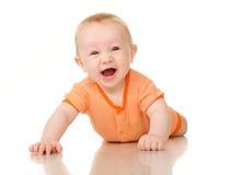 桔子的说谎的滑稽的男婴 库存照片