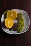 桔子,猕猴桃,巧克力 免版税库存图片