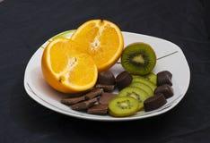 桔子,猕猴桃,巧克力 免版税库存照片