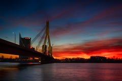 桥梁在日落的里加 免版税库存照片