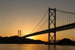 桥梁的剪影在日落的 免版税图库摄影