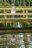 桥梁的女孩 免版税图库摄影