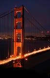 桥梁门金黄轻的晚上 图库摄影