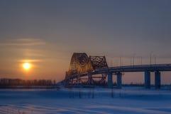 桥梁龙红色日落 图库摄影