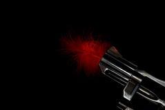 桶用羽毛装饰的枪红色 库存图片